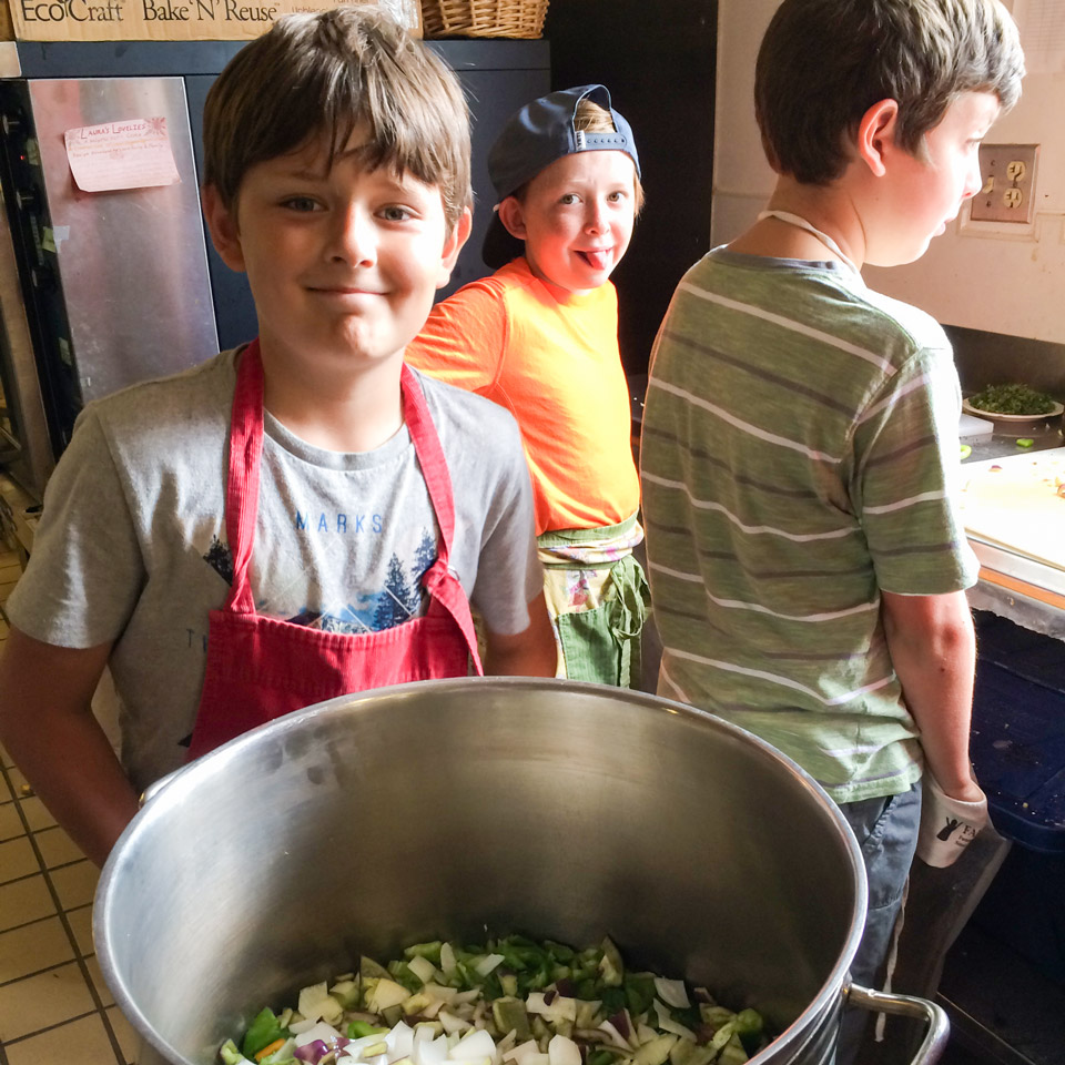 Three boys preparing lunch image